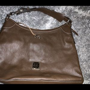 Brown leather dooney and bourke bag with dust bag